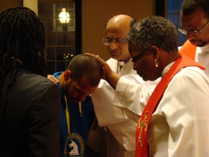 Bishop Devadhar and others pray with Stan Smith, a member of Union UMC who was running the Boston Marathon when the explosions happened. Photo & Article by Alexx Wood http://www.neumc.org/news/detail/773
